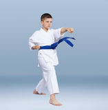 With a blue belt karate athlete beats punch arm. With a blue belt karate athlete beats punch stock photography