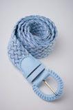 Blue belt. Women belt on a gray background Royalty Free Stock Image
