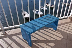 Blue bench above the sea Royalty Free Stock Photography