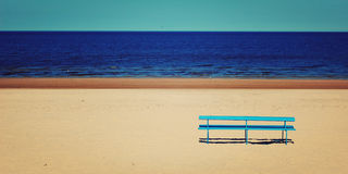 Blue bench Baltic sea - wide vintage photo. Royalty Free Stock Photography