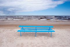 Blue bench on the beach Stock Photo