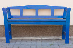 Blue bench in front of a house Royalty Free Stock Photo