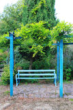 A blue bench Stock Image