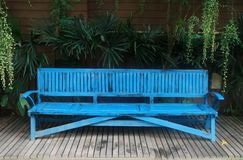 Blue bench in garden Stock Photos
