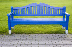 Blue bench isolated on green grass Stock Images