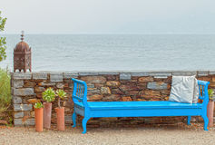 Blue Bench Low Stone Wall on Water Stock Image