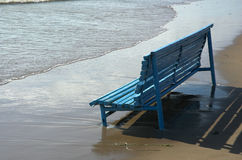 Blue bench on seacoast Stock Photo