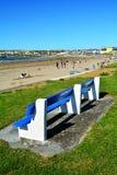 The blue bench. Sunny evening in Kilkee County Clare, Ireland Royalty Free Stock Photos