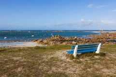 Bench with ocean view at Brittany beach. Blue bench with a view over Meneham beach, Brittany, France Stock Images