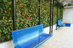 Blue benches. In bus station in Limassol,Cyprus Stock Photos