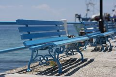 Blue benches at seaside Stock Photos