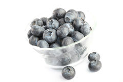 Blue berries. A cup of blue berries on white background Royalty Free Stock Photo