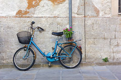 Blue Bicycle against an Exterior Wall stock image