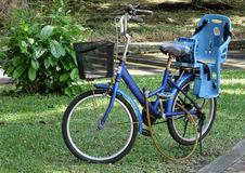 Blue Bicycle. A blue bicycle with child seat and basket royalty free stock images