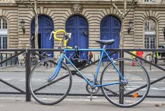 A blue bicycle at downtown in Paris, France royalty free stock photography