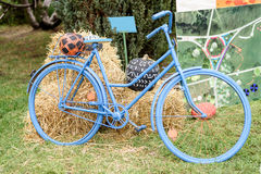Blue bicycle with hay and pumkpins decoration royalty free stock images