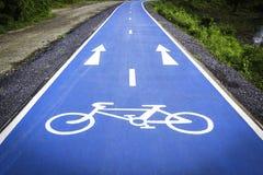 Blue bicycle symbol lane. Bicycle symbol lane on the blue background road Stock Photo