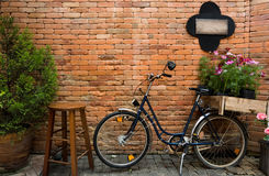 Blue bicycle with wooden box of flowers Royalty Free Stock Photography