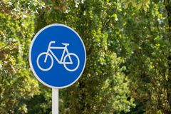 Bicycles Only Road Sign on Green Background stock photos