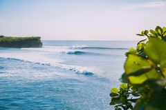 Blue big waves for surfing in Bali. Ocean wave in Indonesia. Blue big waves for surfing in Bali. Ocean wave Royalty Free Stock Images