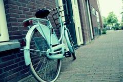 Blue bike. City-bicycle parked near Dutch house. Blue bike in Delft, Holland. City-bicycle parked near Dutch house Stock Photo