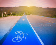 Blue bike lane asphalt texture Stock Photos