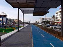 Blue bike lane on the Boulevard under the roof Stock Images