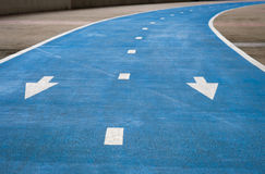 Blue bike lane , one-way ride . Royalty Free Stock Images
