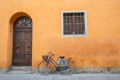 Blue Bike on Orange Wall Stock Photos