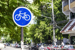 Blue bike sign, bike lane symbol in downtown city Stock Images