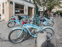 Blue Bike Tours bicycles parked outside bookstore in Paris Royalty Free Stock Photos