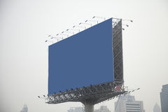 Blue billboard. On city and sky stock photography