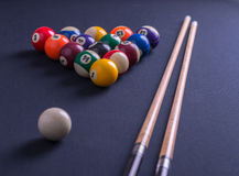 Blue billiard table with all balls and cues. Stock Photos