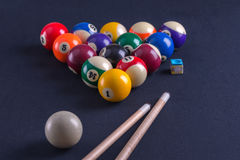 Blue billiard table with balls and cue. Stock Image