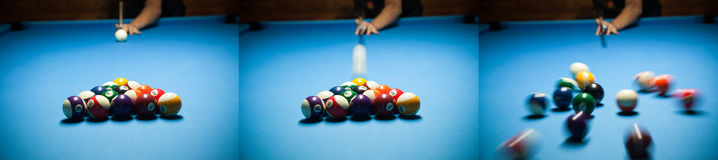 Blue billiard table with colorful balls, beginning of game, slow. Motion, soft focus, snooker bar, entertainment in nightclub, hobby and sport concept.Action Royalty Free Stock Photos