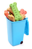 Blue bin full of dog treats Stock Photos