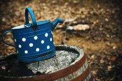Blue Bin on Wooden Barrel Royalty Free Stock Photos