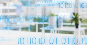 Blue binary code against blurry white office Stock Images