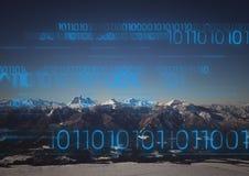 Blue binary code against mountains. Digital composite of Blue binary code against mountains Royalty Free Stock Photos