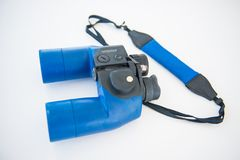 Blue binoculars is accessory for travel. Optical instrument Royalty Free Stock Image