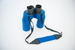 Blue binoculars is accessory for travel. Optical instrument Stock Photo