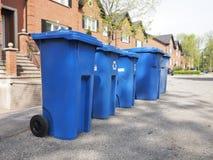 Blue bins in a row Stock Photos