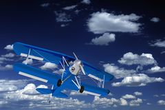 Blue Biplane on the Sky Royalty Free Stock Photo