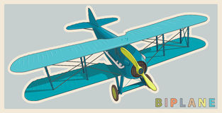 Blue biplane in vintage and color stylization. Model aircraft propeller. Royalty Free Stock Photography