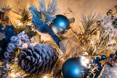 A blue bird Christmas ornament sitting in flocked garland. A blue bird Christmas ornament sitting in a flocked garland, Woodstock, Georgia, USA royalty free stock images