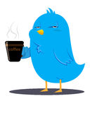 Blue bird drinking coffee Royalty Free Stock Photography