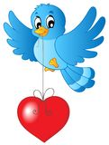Blue bird with heart on string Royalty Free Stock Images