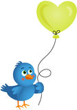 Blue bird holding heart balloon Stock Photography