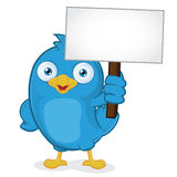 Blue Bird Holding Sign. Clipart Picture of a Blue Bird Cartoon Character Holding Sign Royalty Free Stock Image