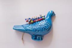 Blue bird. Isolated blue bird with evil eye stock photo